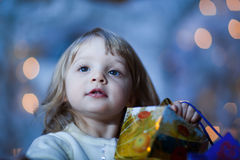 Girl with gift. Close-up portrait of a little girl with a gift - shallow DOF, focus on eyes Royalty Free Stock Photography