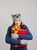 Girl with a gift Stock Photos