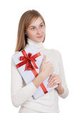 Girl with a gift. Portrait of a beautiful girl with a gift in their hands. isolated on white Stock Photos