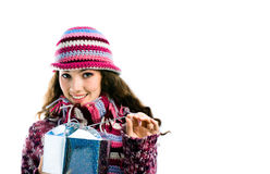 Girl with a gift. A girl with a gift on the white background stock images