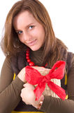 Girl and gift. In her hands Royalty Free Stock Images