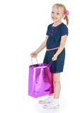 Girl with a gift bag in his hand Stock Photo