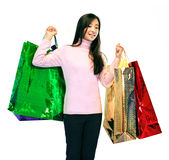 Girl With Gift Bags. Girl standing holding gift bags on a white background Royalty Free Stock Photos