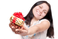 Girl with a gift box Stock Photos