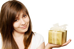 Girl with a gift  box. Beautiful young teen girl with a gift  box in her hand Royalty Free Stock Image