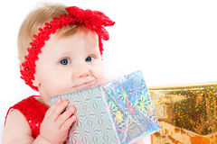 Girl and gift box Stock Photos