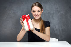 Girl with gift box. Girl holding a box with a gift Royalty Free Stock Photography