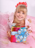 Girl with gift box. Girl in the pink dress with gift box Stock Image