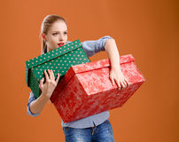 Girl with a gift box on a beige background Royalty Free Stock Image
