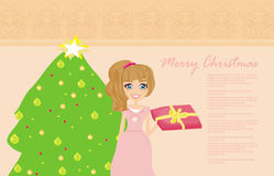 Girl with gift box near by Christmas Tree Stock Photos