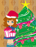 Girl with gift box near by Christmas Tree Royalty Free Stock Photo