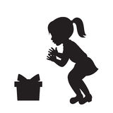 Girl and the gift box silhouette. Stock Photos