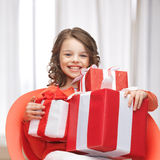 Girl with gift boxes Stock Image