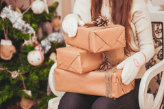 Girl with gift boxes Stock Photography