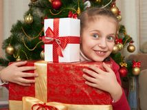 Girl with gift boxes near christmas tree, happy holiday and winter celebration Royalty Free Stock Photography