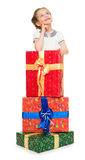 Girl with gift boxes Stock Images