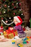 Girl gift a Christmas present Stock Photography