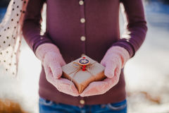 Girl with a gift in her hands Stock Photos