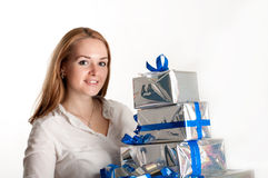 Girl with a gift on a light background Stock Photography