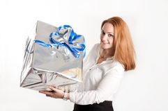 Girl with a gift on a light background Royalty Free Stock Photos