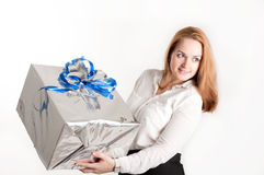 Girl with a gift on a light background Royalty Free Stock Image