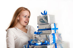 Girl with a gift on a light background Stock Photo
