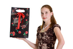 Girl with gift package Stock Photos