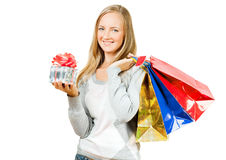A girl with a gift and packages Royalty Free Stock Image