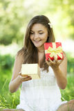 Girl with gift in the park Royalty Free Stock Photos