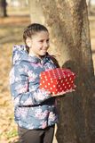 The girl with a gift in the park Royalty Free Stock Image