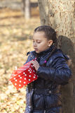 The girl with a gift in the park Stock Photo