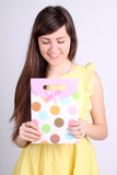Girl with a gift. In peas Stock Images