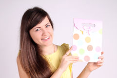 Girl with a gift. In peas Royalty Free Stock Photography