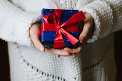 Girl with a gift in their hands Stock Images