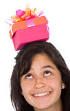 Girl with gift on top Stock Images