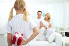 Girl with giftbox Stock Image