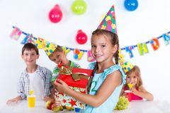 Girl with giftbox at birthday party Royalty Free Stock Photography