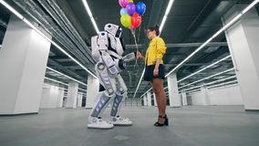 A girl gifting colorful balloons to her friend robot. stock footage