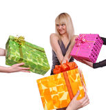 Girl and gifts. The young girl accepts gifts from different directions Royalty Free Stock Image