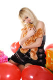 Girl with gifts. The young girl presses to itself a soft toy Stock Images