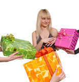 Girl and gifts. The young girl accepts gifts from different directions Stock Image