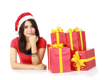 Girl with a gifts looking at camera Stock Photos