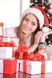 Girl with  gifts near the Christmas tree Royalty Free Stock Photos