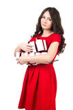 Girl with gifts. Girl with presents on a white background in a red dress Royalty Free Stock Image