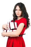 Girl with gifts. Girl with presents on a white background in a red dress Royalty Free Stock Photos