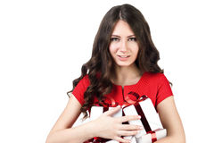 Girl with gifts. Girl with presents on a white background in a red dress Stock Image