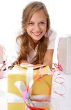 Girl among gifts Stock Image