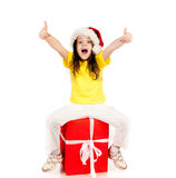 Girl with gifts in santa hat Royalty Free Stock Images