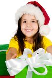 Girl with gifts in santa hat Stock Photo