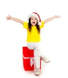 Girl with gifts in santa hat Stock Images